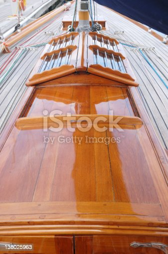 Close-up of a restored wooden hatch on a classic British sailing yacht.
