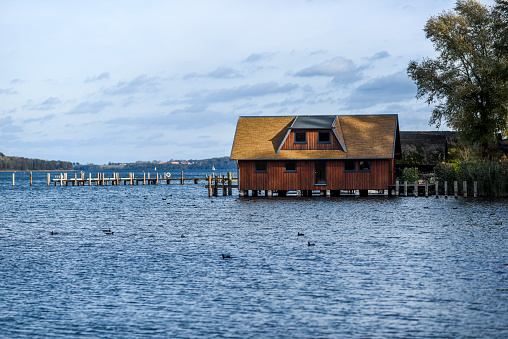 Wooden hause by tle lake in Schwerin in Germany.