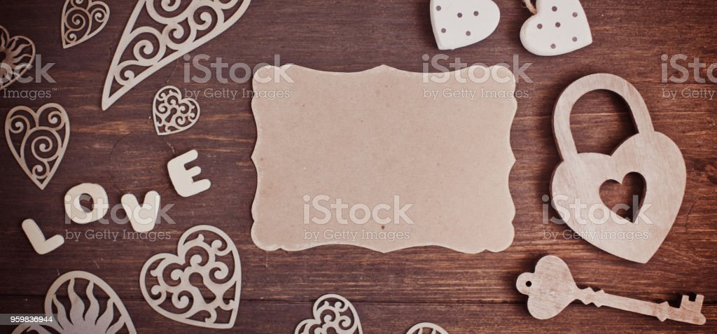 Wooden heart and white flowers on an old wooden board. Backgrounds and textures. St. Valentine's Day. stock photo