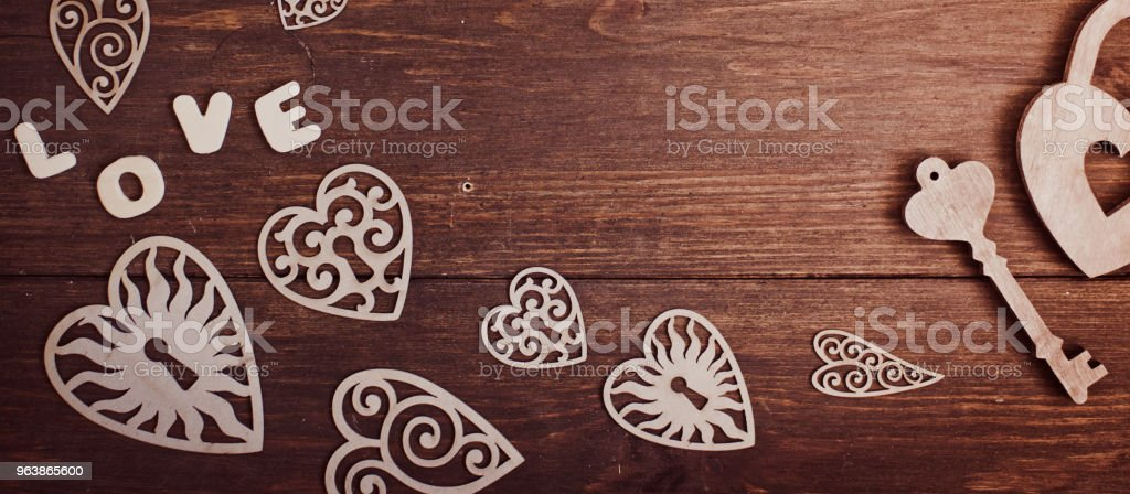 Wooden heart and white flowers on an old wooden board. Backgrounds and textures. St. Valentine's Day. - Royalty-free Archival Stock Photo