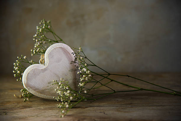 Wooden Heart And White Flowers Rustic Vintage Background Stock Photo