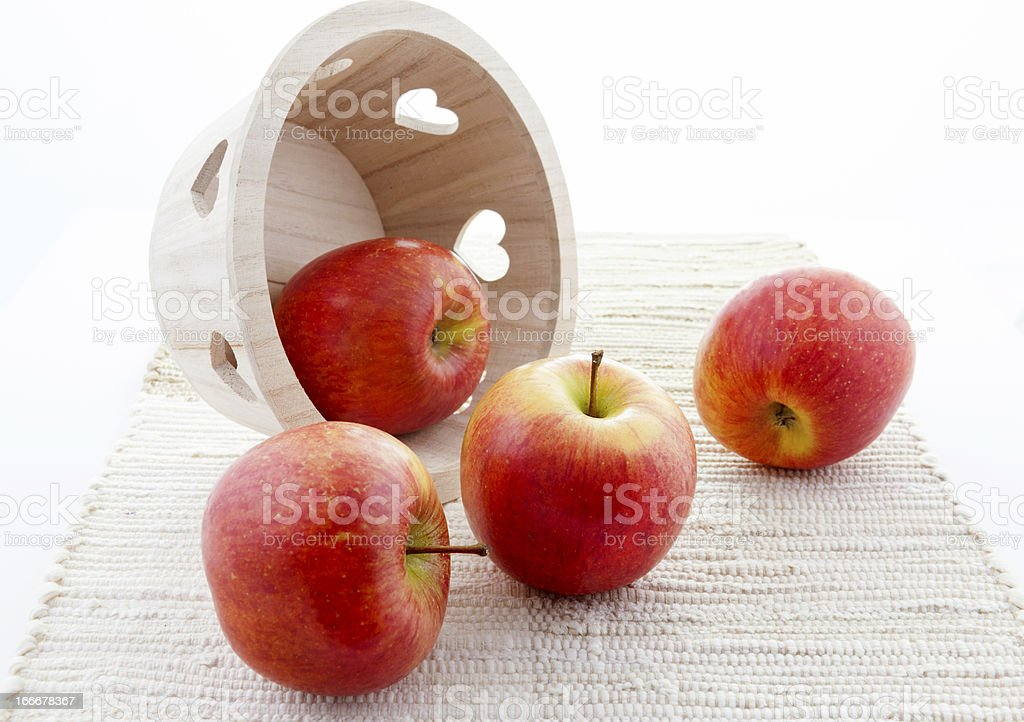 Wooden Heart Basket with Red Kiku Apples royalty-free stock photo