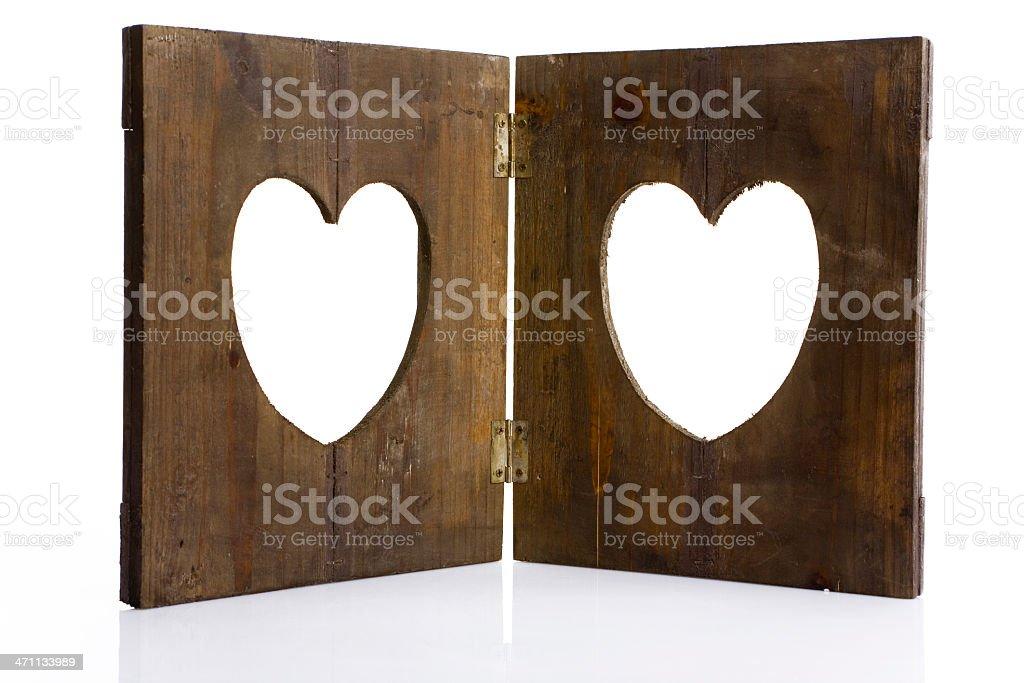wooden heart shape frame on white stock photo