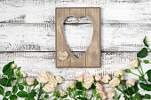 istock Wooden heart shape frame with roses 545987214