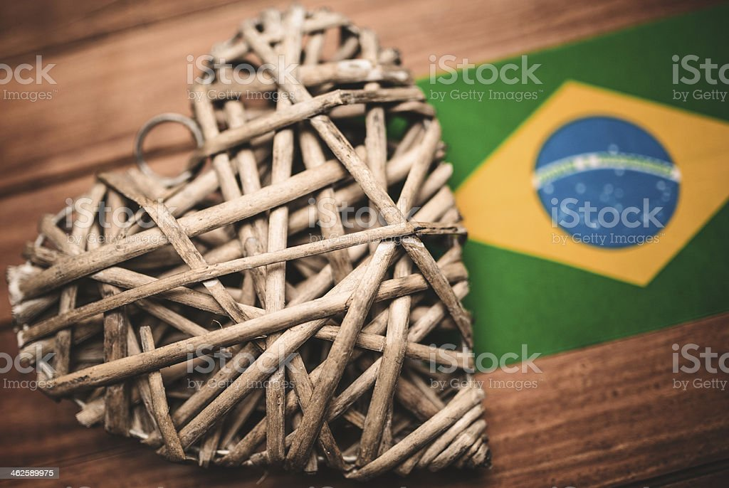 wooden heart shape on rustic vintage plank with brazil flag stock photo