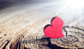 istock Wooden Heart With Sunlight And Flare Effect In Defocused Background - Valentines Day 1298096088