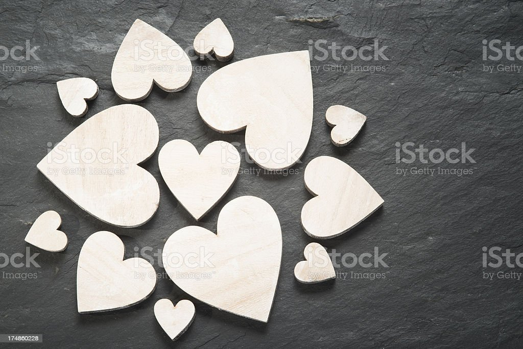 Wooden hearts on slate royalty-free stock photo