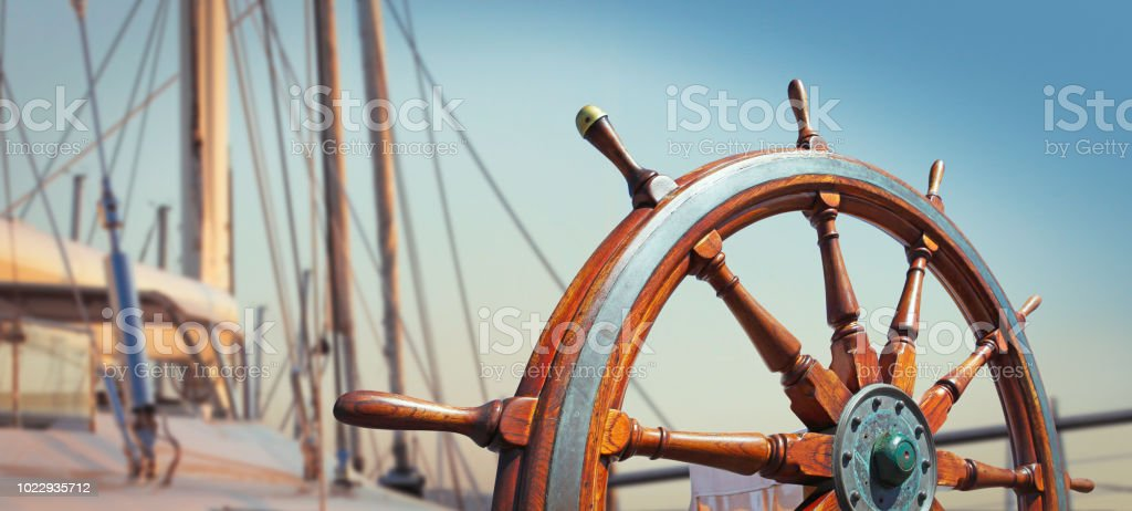 Wooden helm on the yacht stock photo