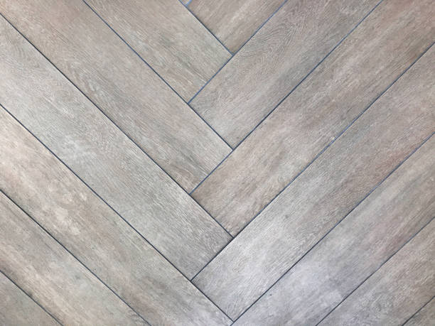 Wooden herringbone pattern texture. Timber panels. Geometric pattern. Decor material. Floor surface stock photo