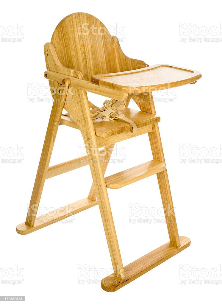 Wooden high chair for babies on white background stock photo