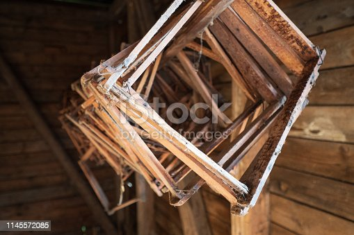 Wolfsegg am Hausruck, Austria - 27th April 2019. Honeycomb frames (without the honeycombs themselves) are threaded on a wooden stick and waiting for their next use by the beekeeper.