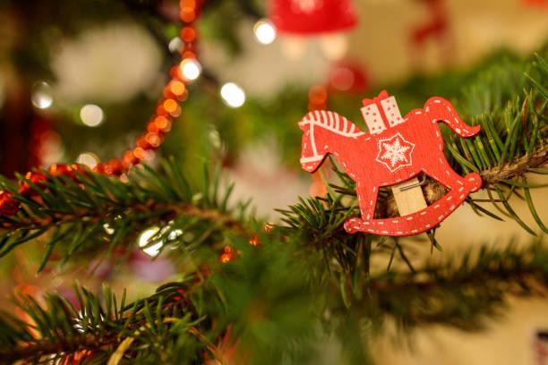 wooden horse decoration on christmas tree stock photo