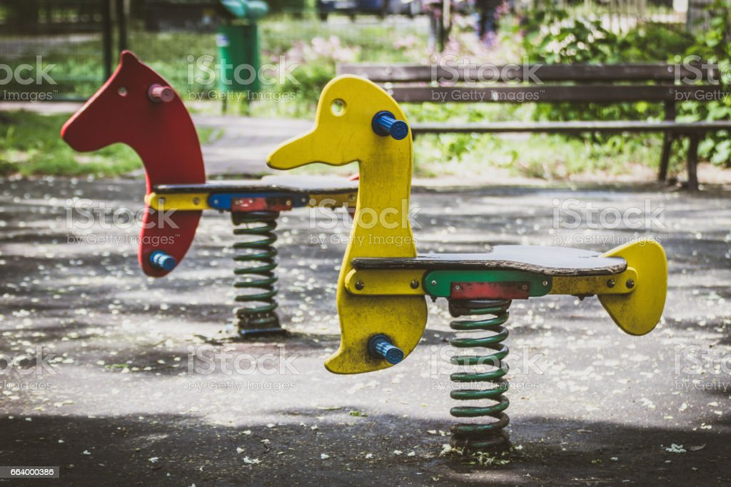 Wooden horses with spring in the park stock photo