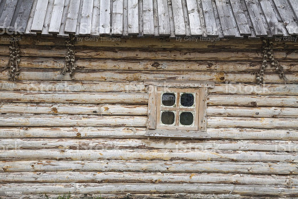 Wooden house and a window royalty-free stock photo