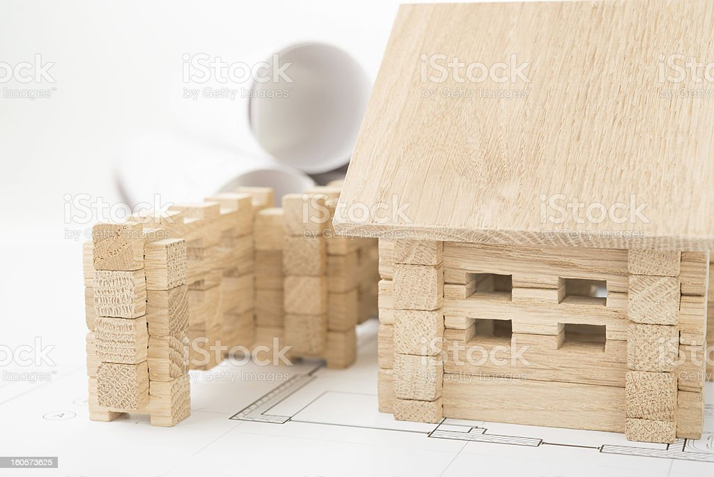wooden house and architectural plans royalty-free stock photo