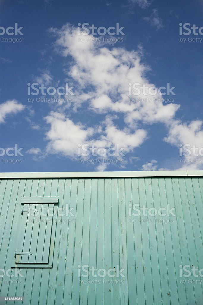 Wooden House And Clouds In The Sky royalty-free stock photo