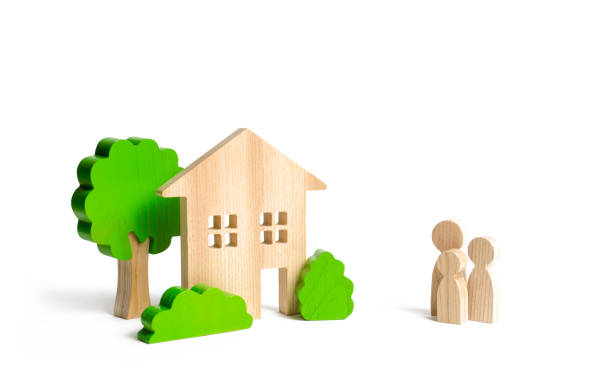 Wooden house and family. Buying a new home. Mortgage and loans. State program of assistance to young families. Subsidy. Quiet and comfortable home in the suburbs. Rental housing, investment. stock photo