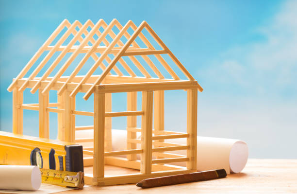 Wooden house and planning on blue sky  construction architecture abstract background concept stock photo