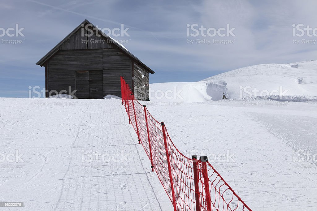 Wooden house and red fence royalty-free stock photo