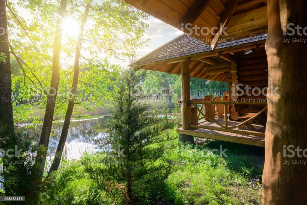 Wooden house and river stock photo