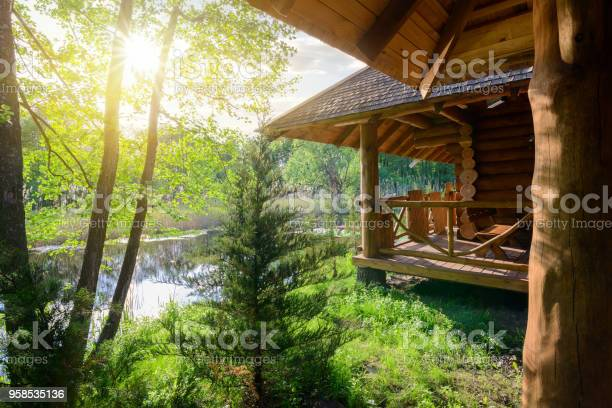 Photo of Wooden house and river