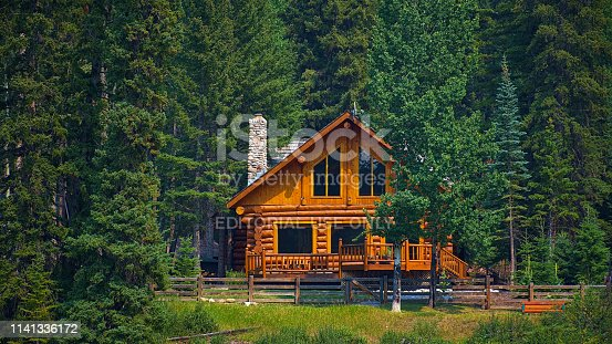 Wooden house commonly found near lakes and rivers. Rocky mountain ( Canadian Rockies ). Portrait, fine art. Near the city of Calgary. Jasper and Banff National Park, Alberta, Canada: August 2, 2018