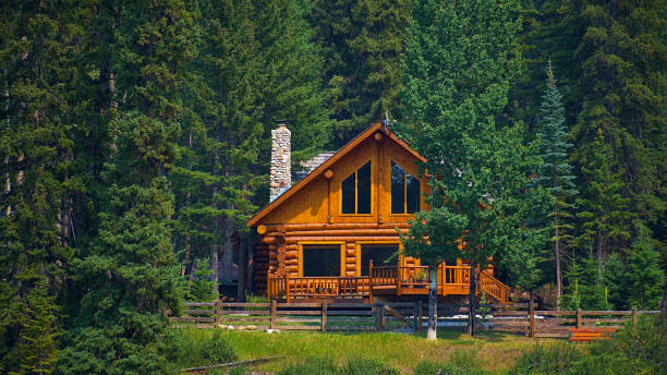 Wooden house commonly found near lakes and rivers. Rocky mountain ( Canadian Rockies ). Portrait, fine art. Near the city of Calgary. Jasper and Banff National Park, Alberta, Canada: August 2, 2018 stock photo