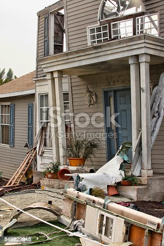 istock Wooden house damaged by disaster. 849822948