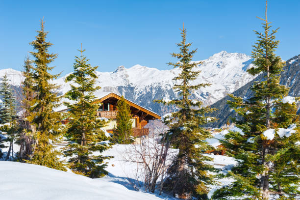 Wooden house in the Alps mountains, winter landscape Wooden house in the Alps mountains, winter landscape. Courchevel, France ski resort stock pictures, royalty-free photos & images