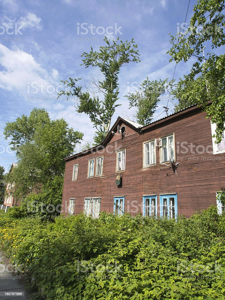 wooden house in the city royalty-free stock photo
