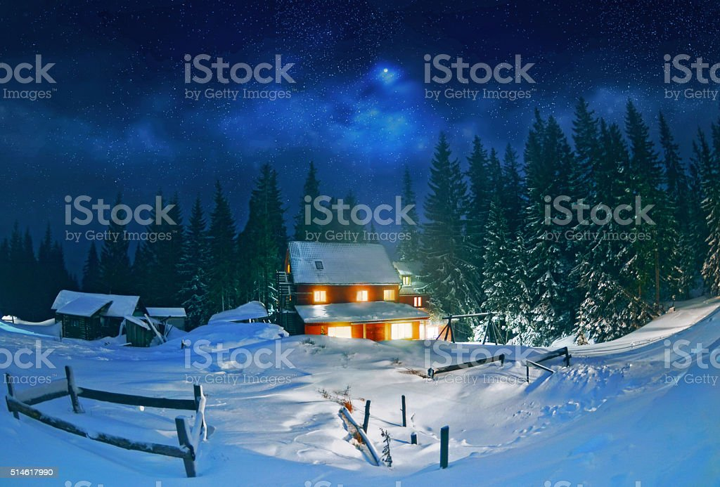 Wooden house in winter forest , Carpathian stock photo
