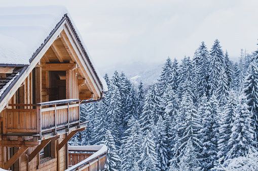 wooden house in winter mountains