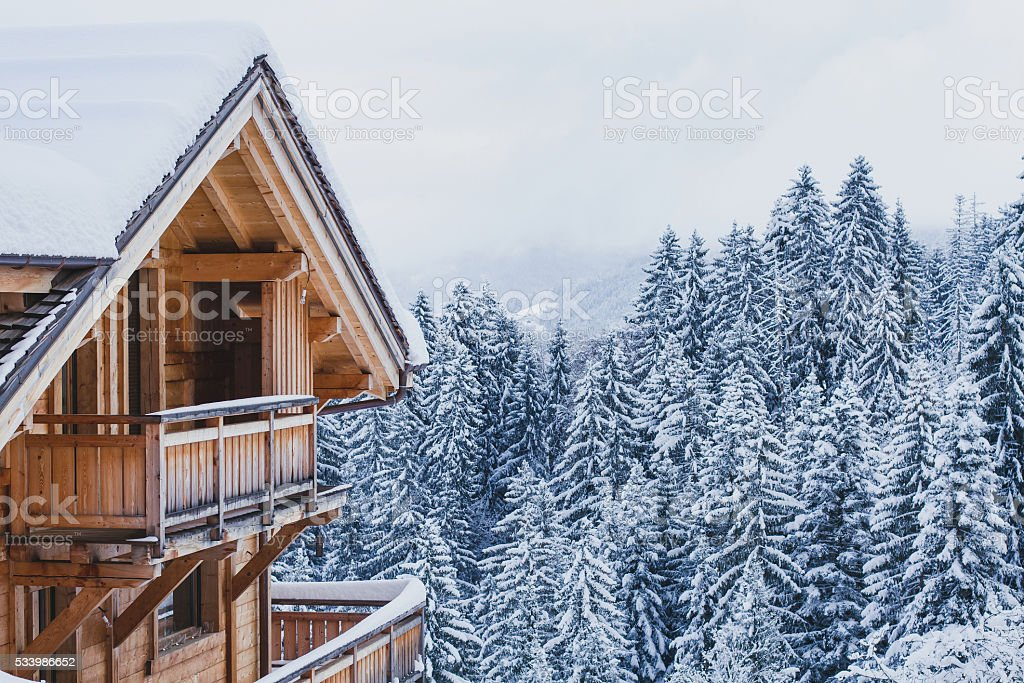 wooden house in winter mountains stock photo