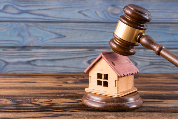 wooden house, judge's gavel on wooden background stock photo