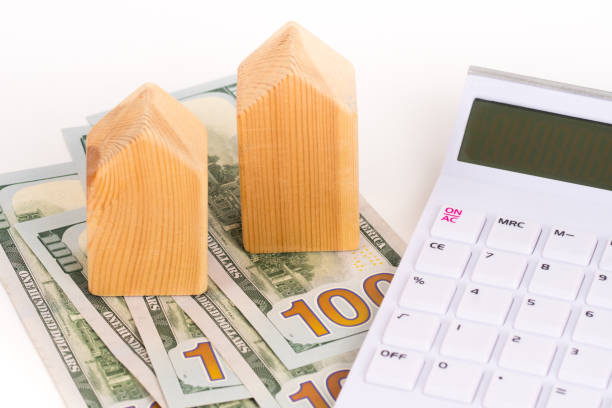 wooden house model with dollars banknotes, buy or rent concept wooden house model with dollars banknotes, buy or rent concept apparently stock pictures, royalty-free photos & images