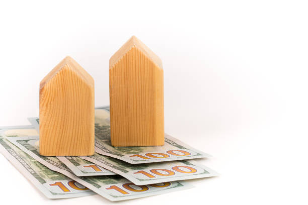 wooden house model with dollars banknotes, realty expensive cost concept wooden house model with dollars banknotes, realty expensive cost concept apparently stock pictures, royalty-free photos & images