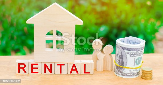 istock Wooden house, money with the inscription rental. Rental of property, apartments. services of a realtor. affordable housing, rental prices. real estate 1056657902