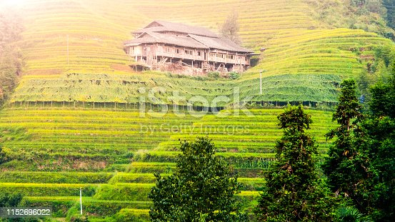 607590542istockphoto Wooden house on Dragon's Backbone Rice Terraces, Longsheng, Guangxi, China 1152696022