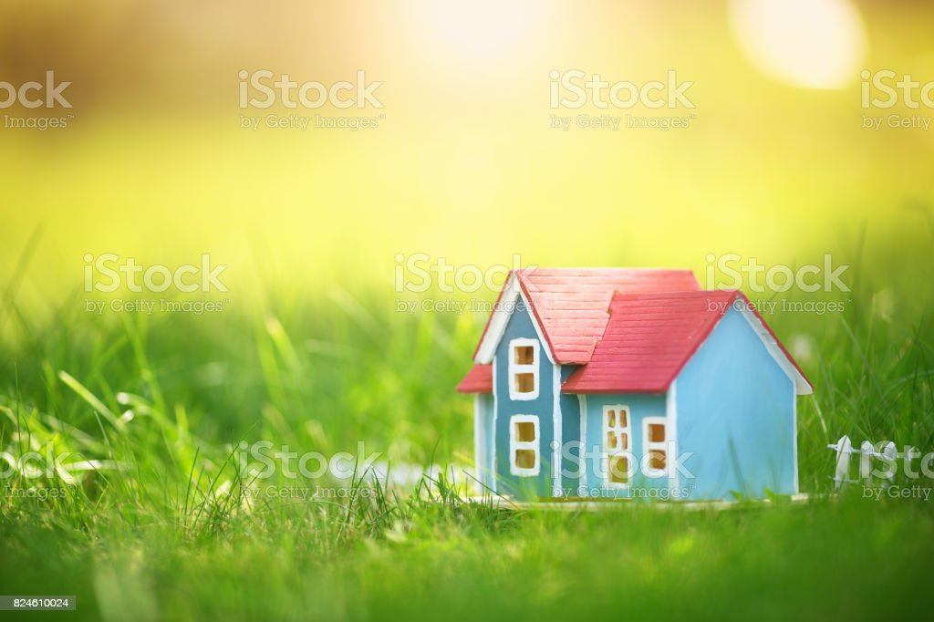 wooden house on the grass stock photo
