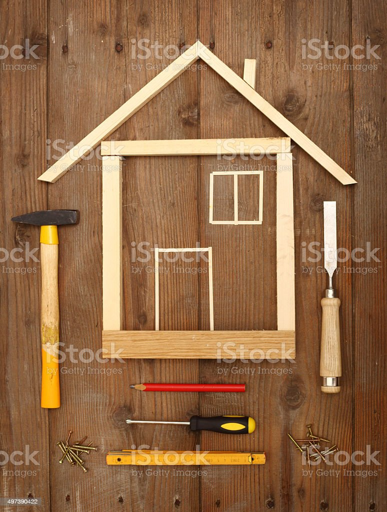 Wooden house Wooden house construction and tools close up 2015 Stock Photo