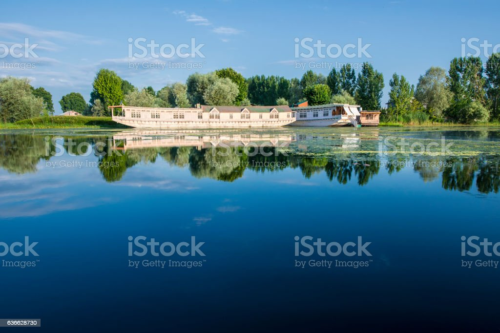 Wooden houseboats on Lake Dal, Kashmir, India stock photo
