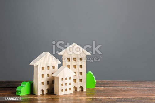 istock Wooden houses. Affordable comfortable housing. Purchase of apartments and real estate, rent and sale. Housing, new home. Modern architecture. Mortgage. Urban Studies and Planning. Copy Space 1188860327