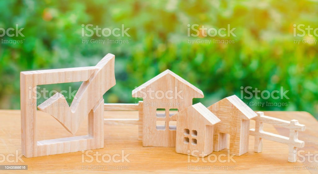 Wooden houses and checkbox. The concept of elections in the municipality. Law on real estate. Local laws. Criteria and advantages of the city. The choice of a new place of residence and home. stock photo