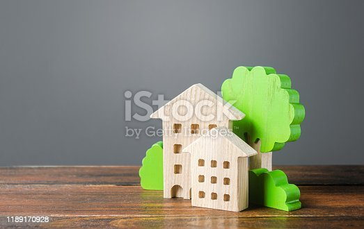 istock Wooden houses and trees. Affordable comfortable housing. Purchase of apartments and real estate, rent and sale. Housing, new home. Modern architecture. Mortgage. Urban Studies and Planning. Copy Space 1189170928