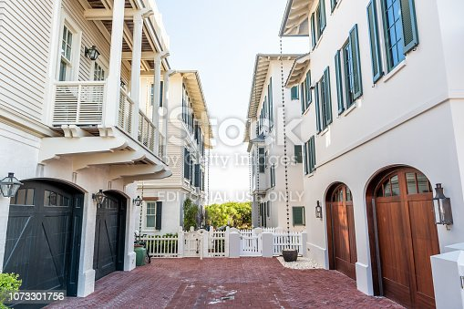 istock Wooden houses community parking garage townhomes, townhouses, by beach ocean, nobody on vacation in Florida view during sunny day 1073301756