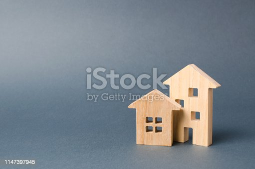 istock Wooden houses figures. Environmentally friendly and environmentally friendly home. Modern technology in construction. Quiet and cozy, comfortable affordable housing. Housing in the suburbs. 1147397945