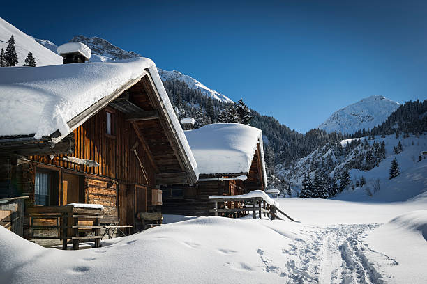 wooden houses on austrian mountains wooden houses on austrian mountains at winter with a lot of snow chalet stock pictures, royalty-free photos & images