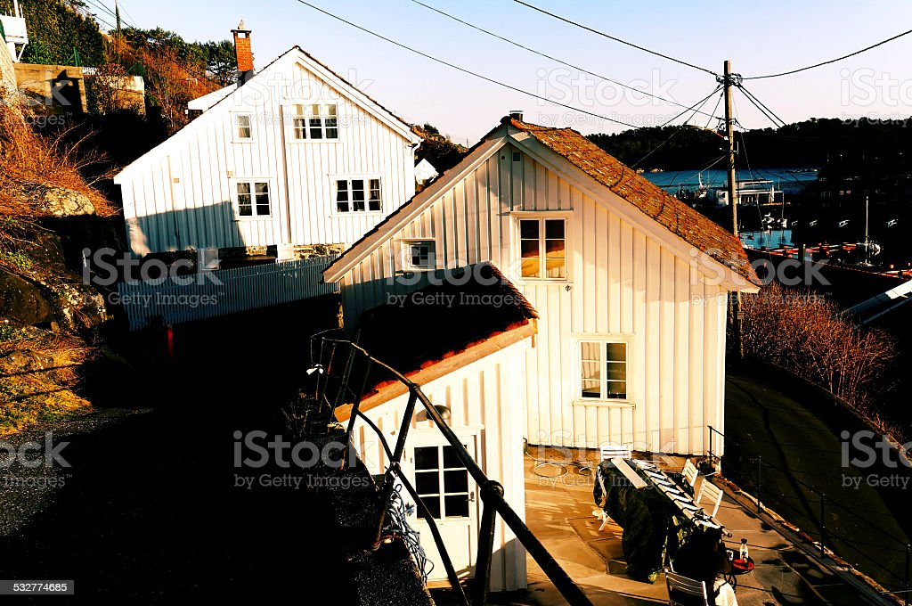 Wooden houses on the narrow street stock photo