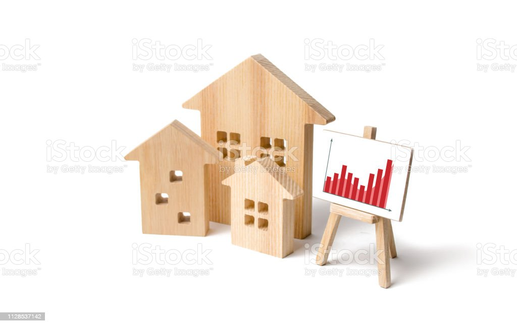 Wooden Houses With A Stand Of Graphics And Information Growing