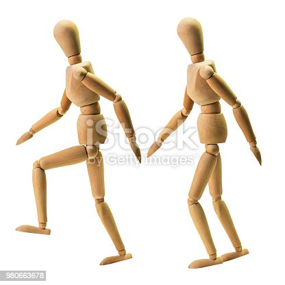Wooden human model in the act of walking isolated on white background with clipping path